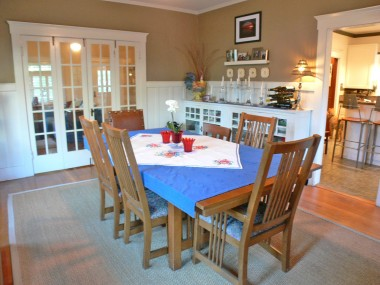 Alternate view of formal dining room, looking towards the original folding French doors which open up into the living room!