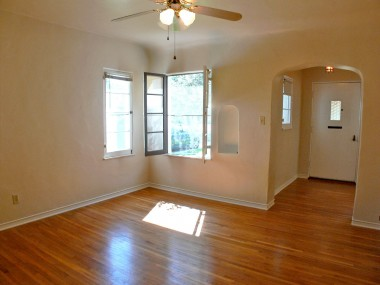 Formal dining room with period telephone alcove, original wood casement windows, coved ceiling, and original hardwood floors!