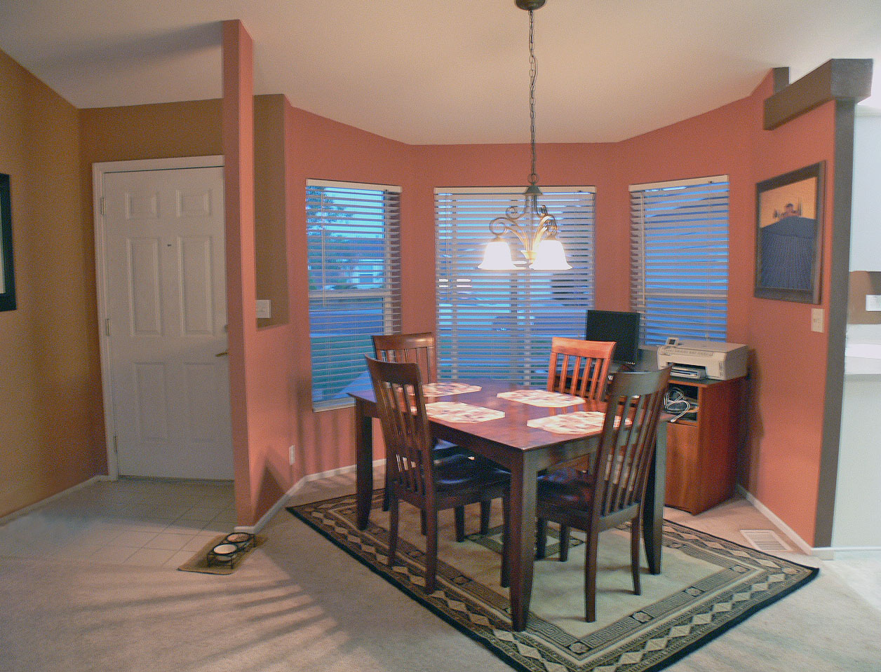 Formal dining area and front entrance.