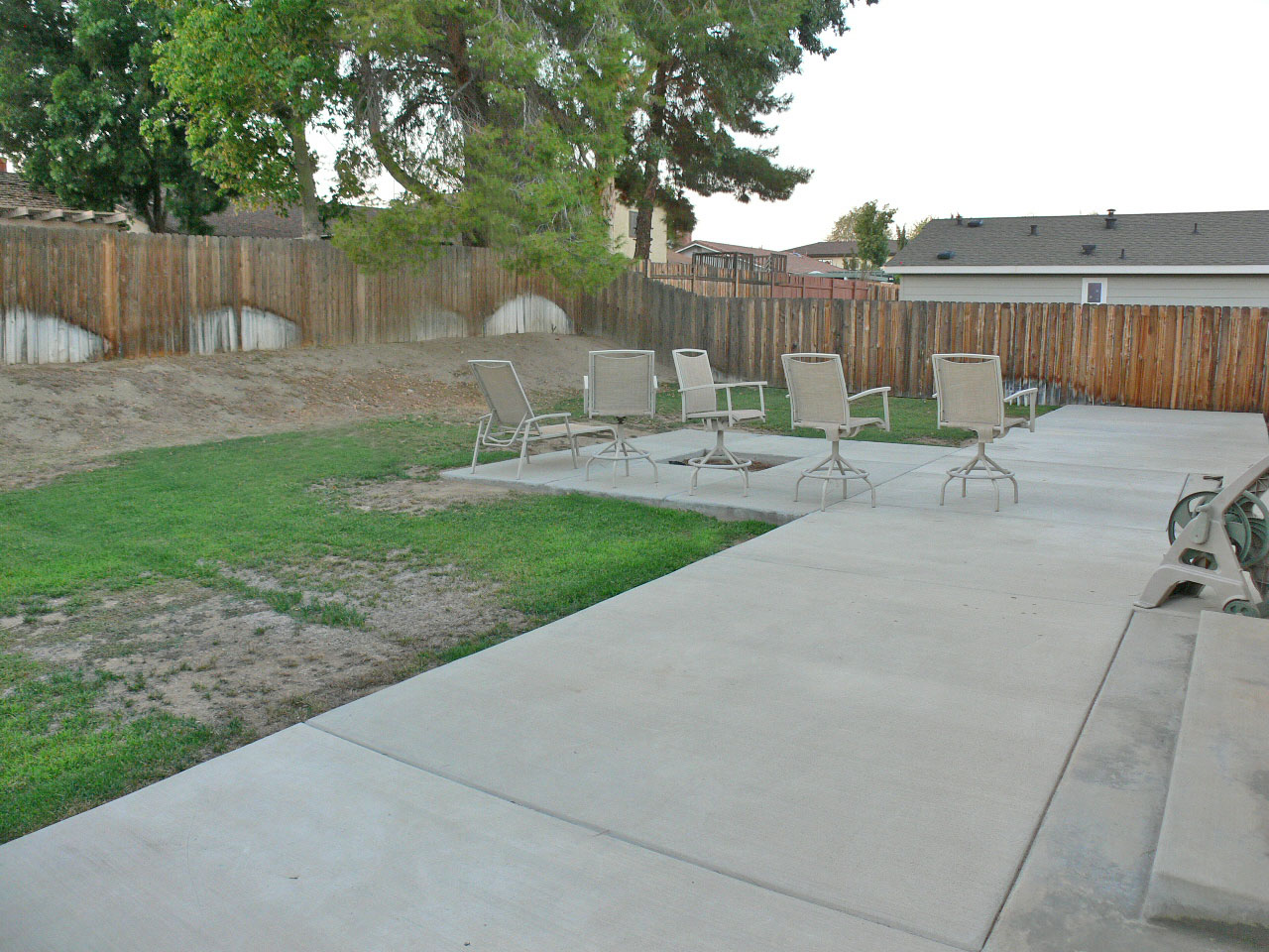 Spacious backyard is a blank slate for whatever type of entertaining and fun you have in mind (basketball court, pool, playground, volleyball, etc).