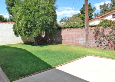 Low maintenance backyard with 60+-yr-old orange tree! Automatic sprinklers and 2-car garage also!