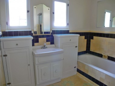 Original unique bathroom tile on floor and tub surround.  There's also a shower stall.