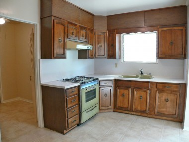 Spacious kitchen with brand new linoleum flooring. Door to left leads to office, half bath, and separate laundry room!
