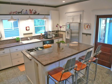 Updated kitchen with granite counter tops, tile floor, convection oven, recessed lighting, and a breakfast bar!