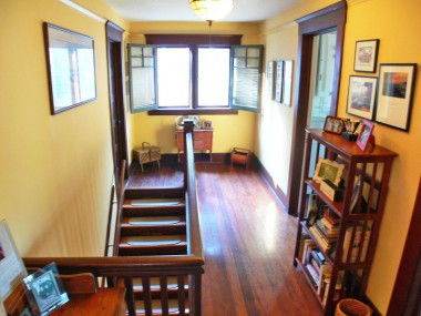 Second floor landing -- note the gorgeous hardwood floors, original wood casement windows, doors, and door frames, along with the baseboards.