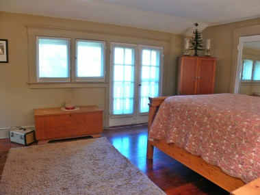 Alternate view of master bedroom -- French doors to private balcony overlooking serene backyard!