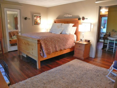 Master bedroom suite with gorgeous hardwood floors, a private bathroom, and a walk-in closet with organizers!