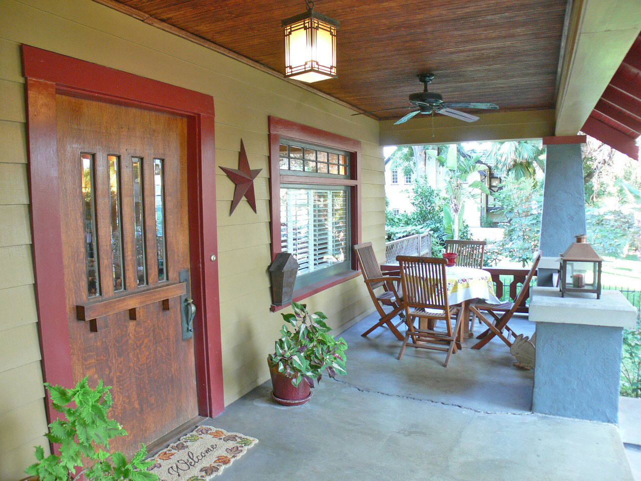 Gorgeous Wood Ceilings Casement Windows And Front Door Two Ceiling Fans On Porch