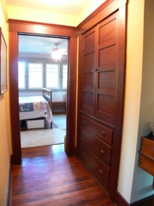 Upper level hallway with linen closet -- note the gorgeous wood floors and wood framing!