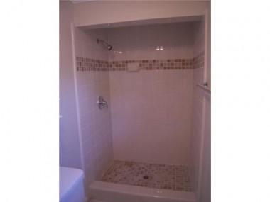 3681 Hoover remodeled master bathroom with custom tile work and pedestal sink.