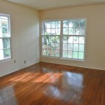 Front bedroom with lots of natural light, recently refurbished hardwood floors and ample closet space.