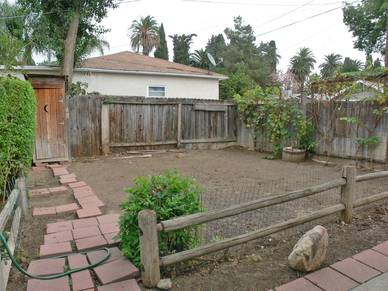 Separate Rustic Fenced Garden Area. Fenced Area To The Right Is For RV  Parking