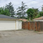 2-car garage off the alley with fenced RV or large toy parking!