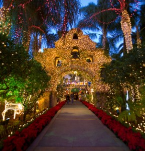 Hundreds of poinsettias line the front walkway into the festive Mission Inn Hotel & Spa