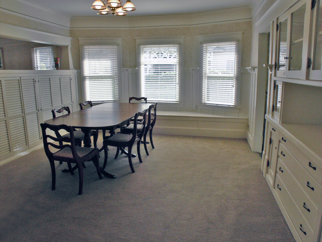Huge formal dining room with built-in China hutch and window seat. Will easily accommodate large gatherings for holidays and entertaining year 'round.