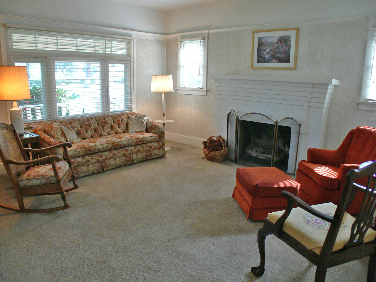 Living room with large baseboards, picture railing, and gas log fireplace are more desirable features of a classic California Bungalow.