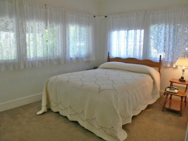 Back bedroom overlooking the backyard with glorious scents of blooming citrus trees.