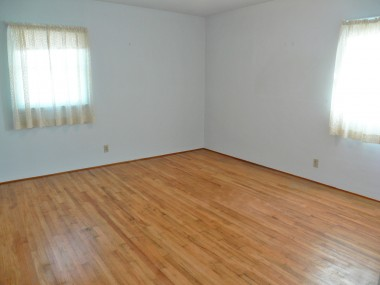 One of THREE good-sized bedrooms, two of which have exposed beautiful hardwood floors and ample closet space!