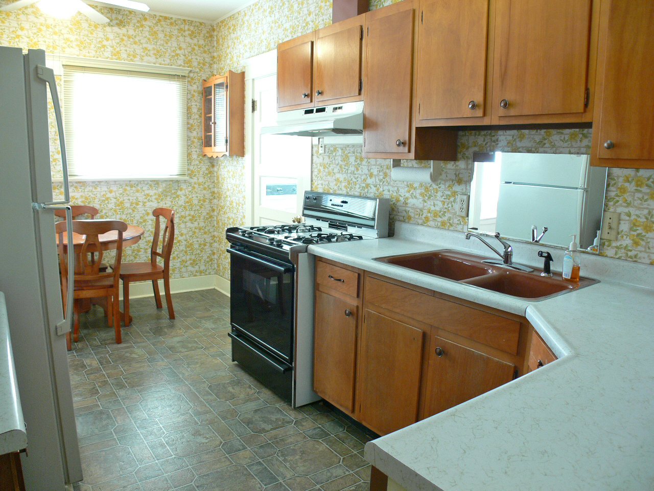 Kitchen was remodeled in the 70's, but it does have a dishwasher, gas stove and casual dining area.