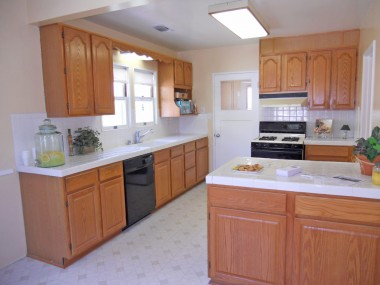 Updated eat-in kitchen with huge walk-in pantry, dishwasher, and informal dining area.