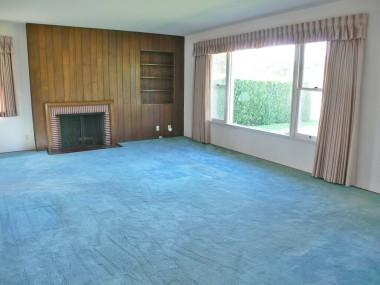 Spacious living room with attached dining area. Hardwood floors under carpeting. See the exposed flooring in front coat closet--they're beautiful!