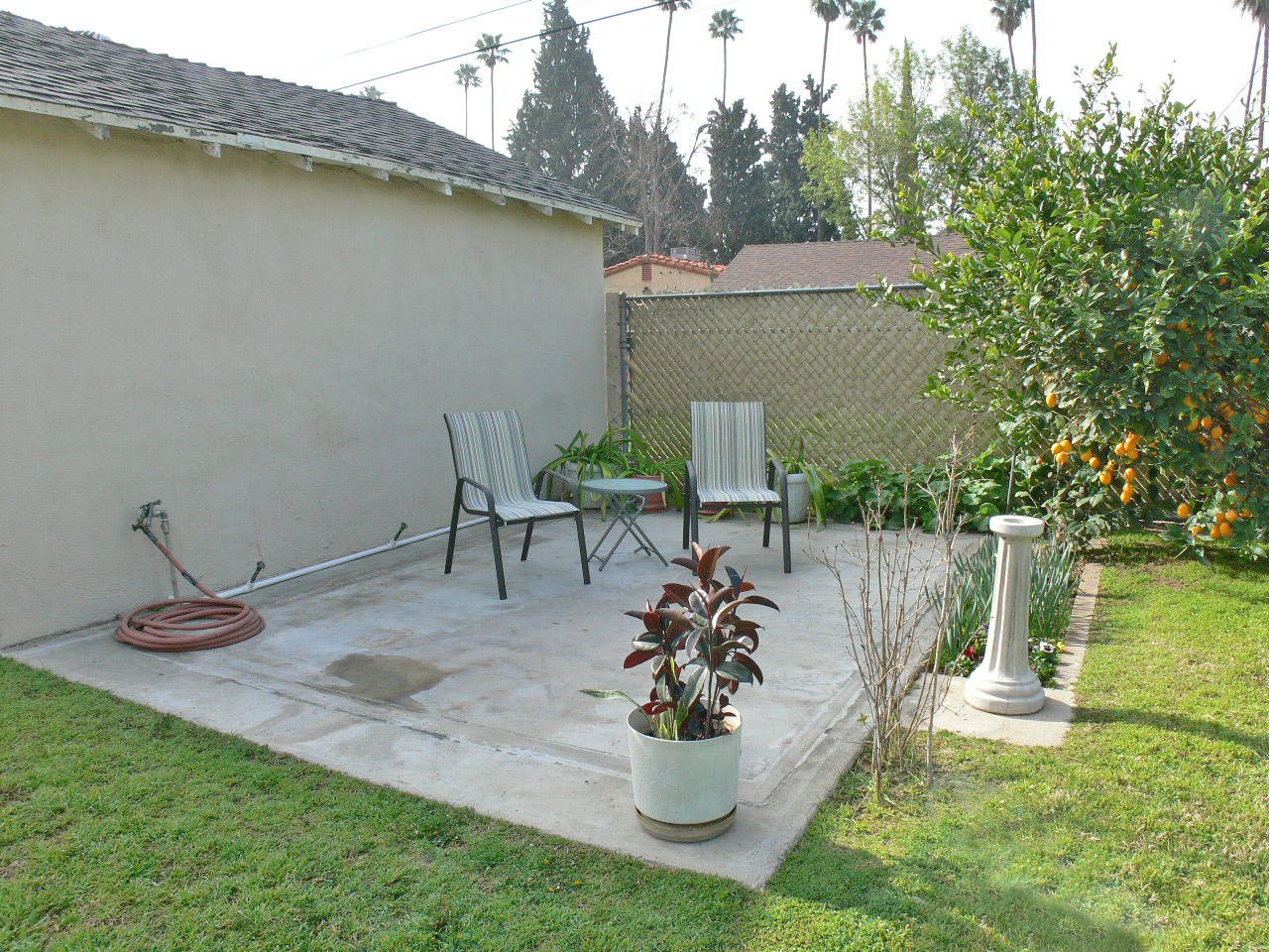 RV pad next to garage is currently set up as a shaded patio.  There's an RV gate off the alley for easy parking access.