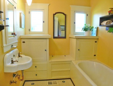 Oh-so-charming bathroom with original sink and built-in cabinetry! There's a separate shower stall as well.