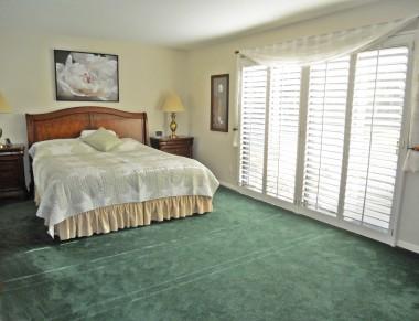 master bedroom suite overlooking the fantastic backyard