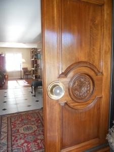 solid rosewood double front doors (featured in Doors of Riverside poster)