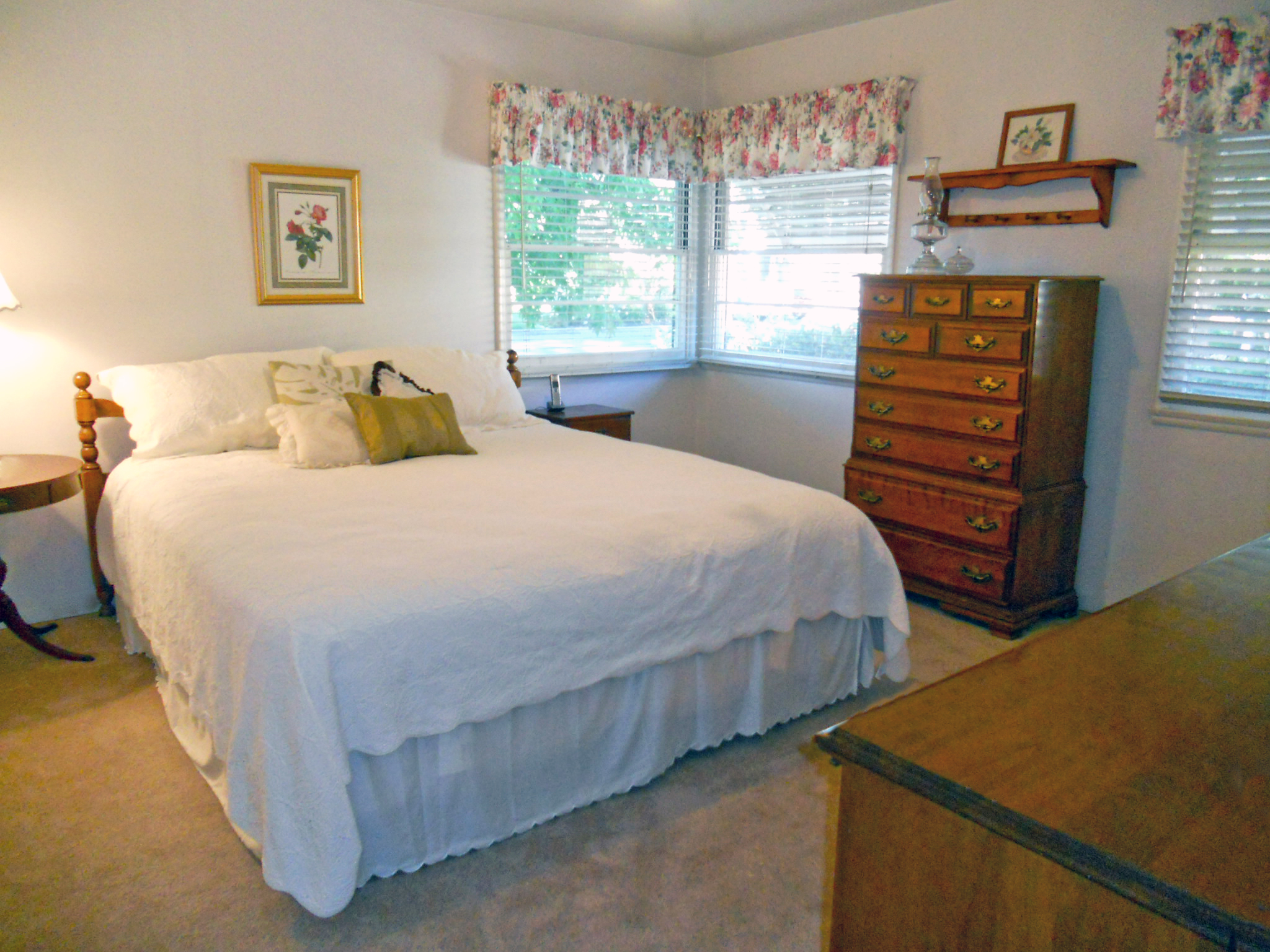 Master bedroom with king-size bed and still plenty of room for dressers, chair, etc.