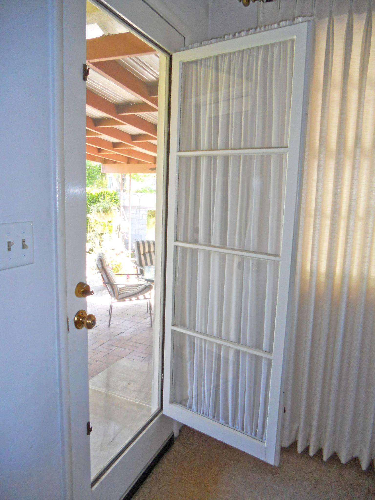 A favorite mid-century door feature -- unlatch the glass paneled door to reveal a screen!
