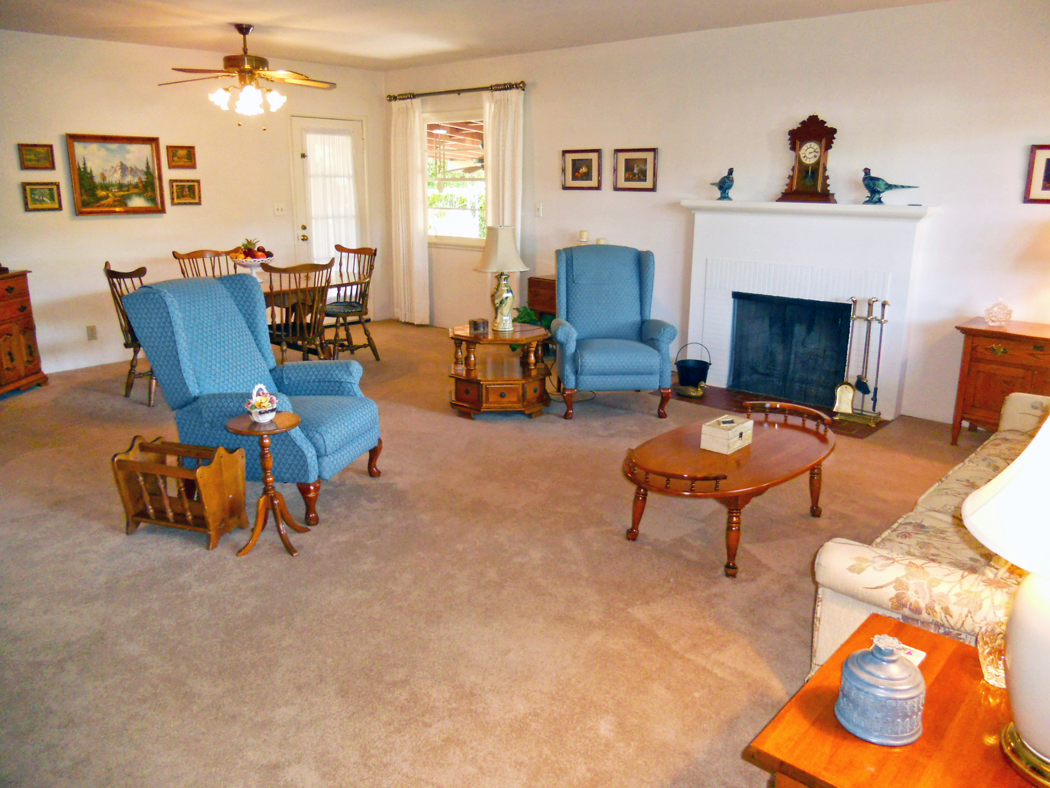 View of living room and dining room as you walk thru front door.