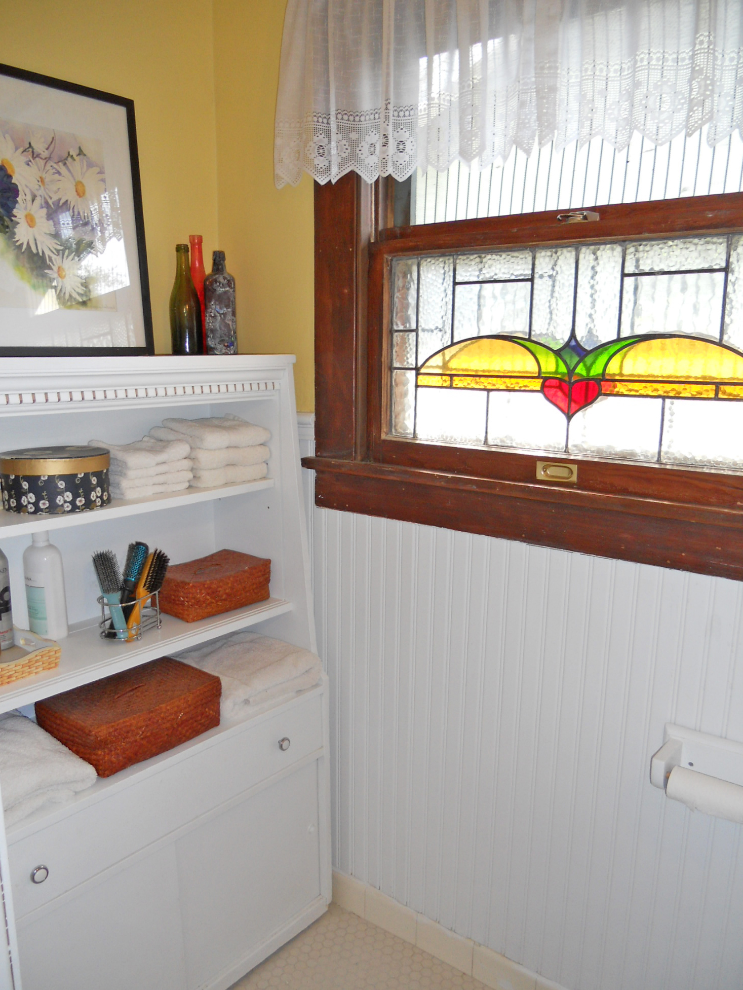 Alternate view of bathroom with beadboard and room for linen cabinet.