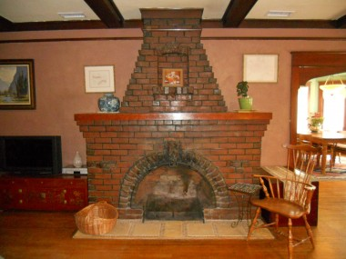 Clinker brick fireplace! These early 20th century misshapen bricks became popular when avant-garde architects used them precisely because they were so unusual!