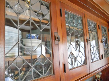 Magnified view of original leaded glass hutch doors!