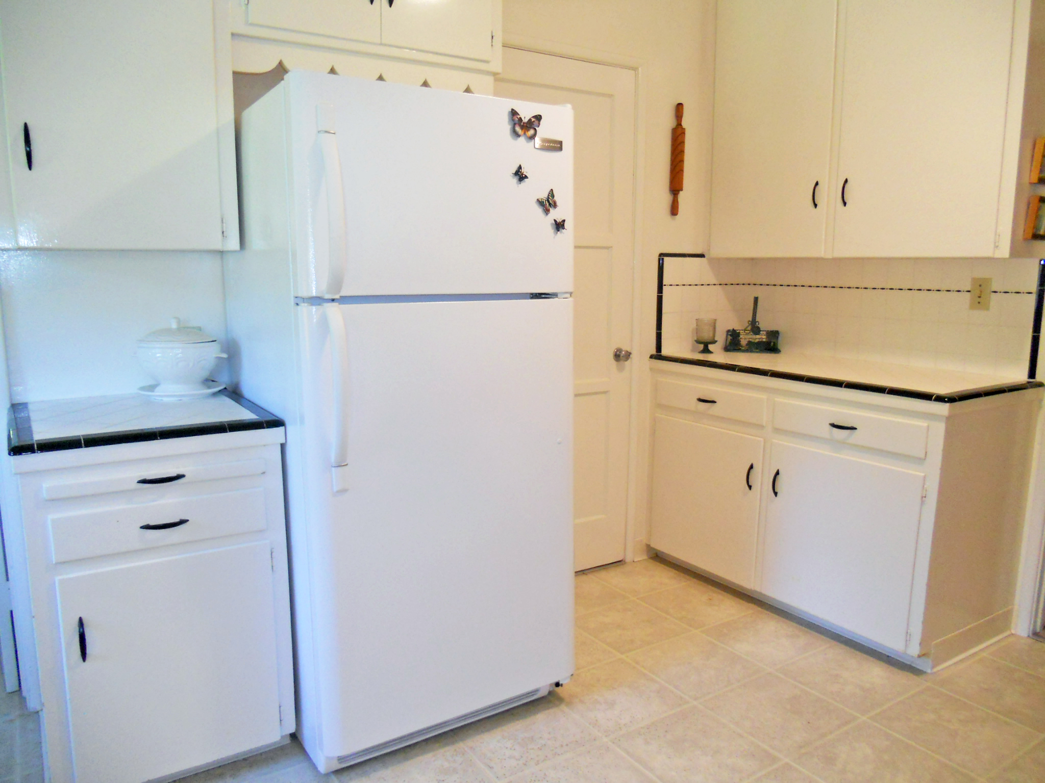 Alternate view of kitchen with more cabinetry.  The refrigerator is inluded!