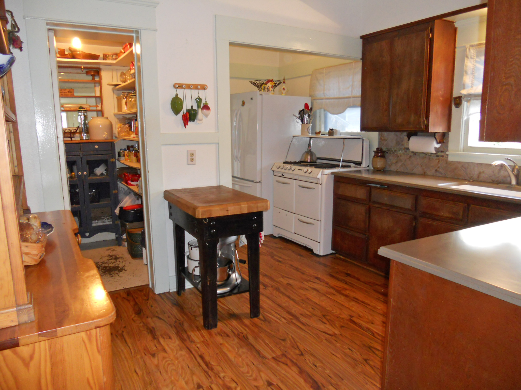 Alternate view of kitchen with walk-in pantry and antique gas stove!