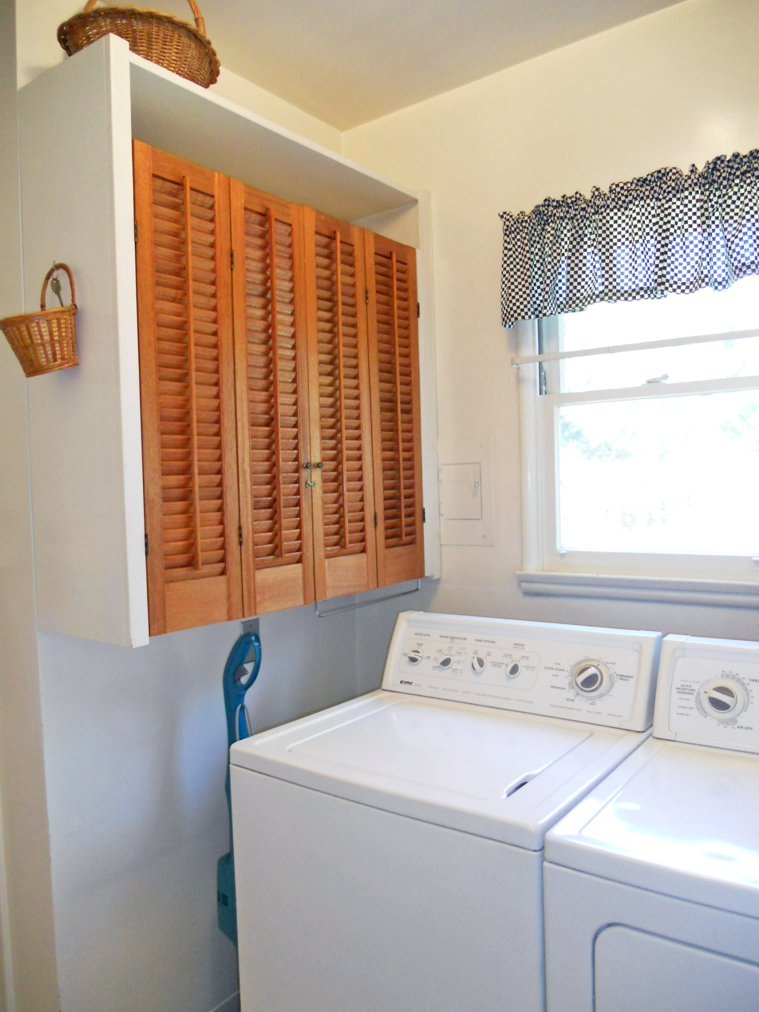 Alternate view of laundry room with more storage (washer and dryer are included).