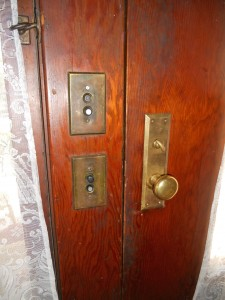 Original push-button lite switches next to front door.