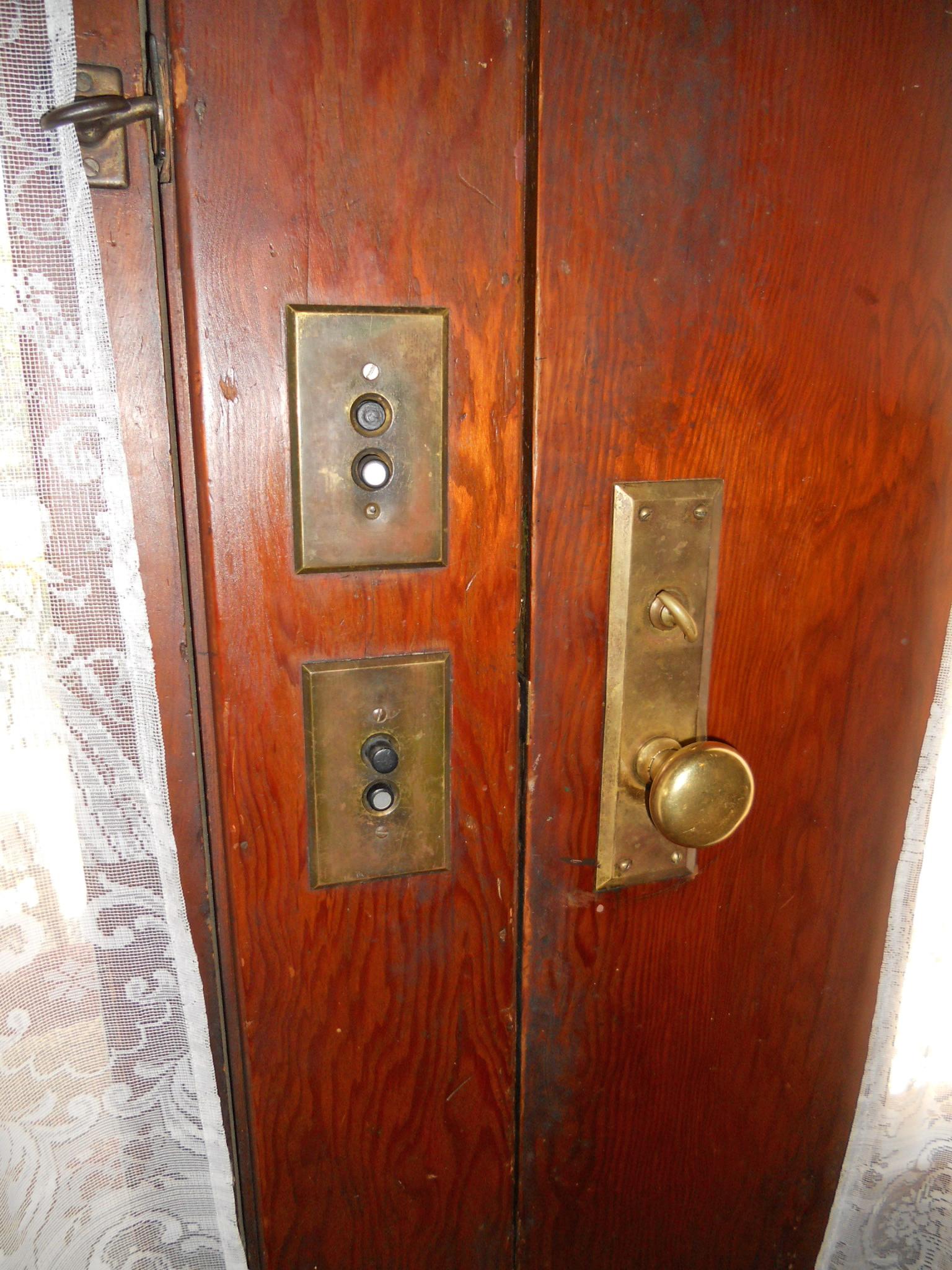 Original push-button lite switches next to front door.