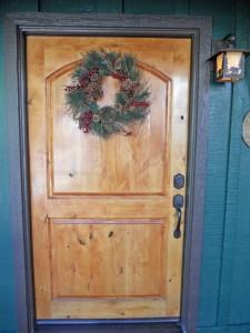 Welcome home! Gorgeous wood front door.