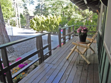 Large re-stained front porch -- gateway to cabin happiness!
