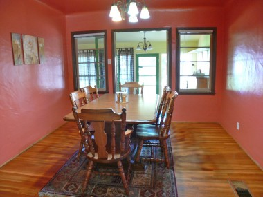 Formal dining room with French doors leading to sun room.