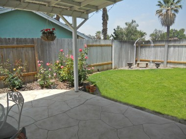 View of right side of backyard from patio.