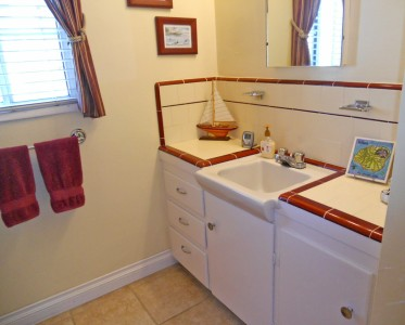 3/4 bathroom (incuding shower stall) with original counter top tile in great condition.