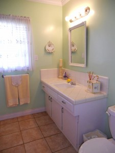 Full bathroom (including shower in tub) with tile flooring.