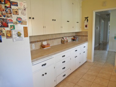 Alternate view of kitchen with extraordinary amount of cabinetry and drawers.