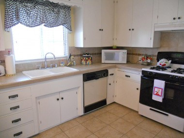 Stone tile counter tops, dishwasher, gas stove.