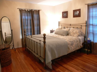 Master bedroom with hardwood floors and large enough to accommodate a king-sized bed!