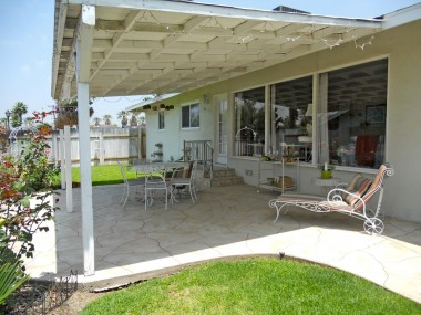 Convenient covered patio, perfect for keeping living room shaded and cool during warm months.